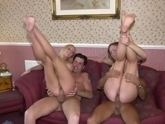 Two babes and two hunks gangbanging naughtily on the couch